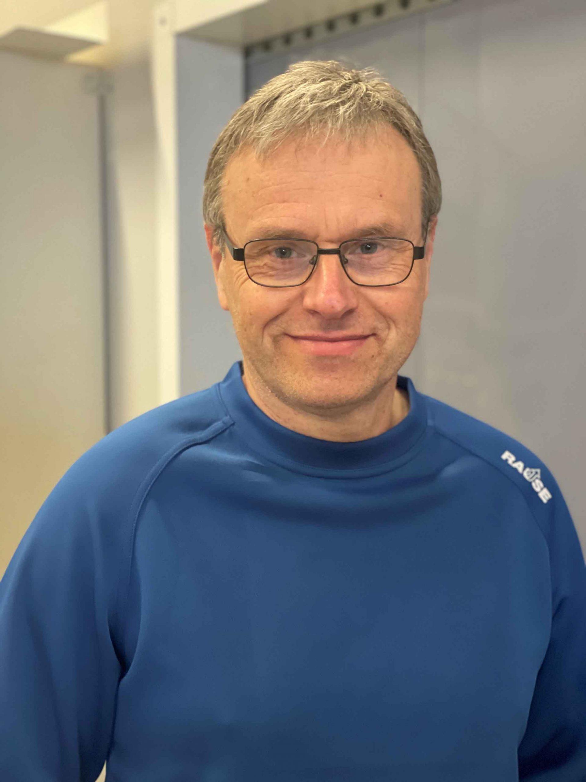 Portrettbilde av Bjørn Midtfjell.